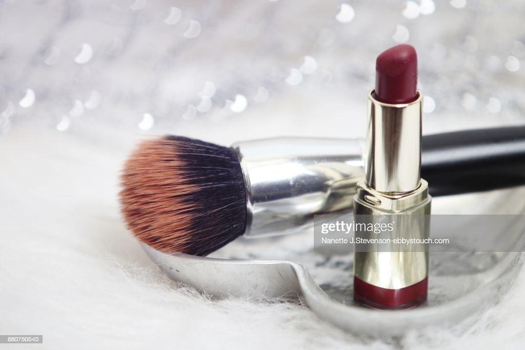 Closeup of makeupbrush and lipstick : Stock Photo