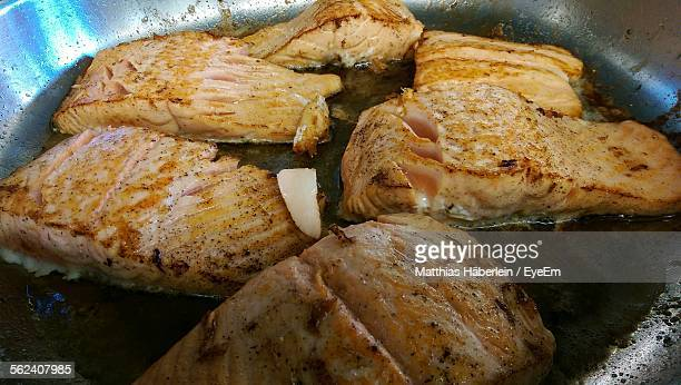 Close-Up Of Making Fish Fried In Frying Pan