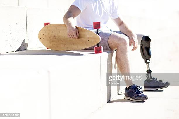 Close-up of male amputee skateboarder's artificial limb