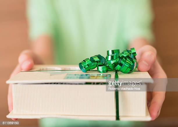 Closeup of male hands holding a Christmas present or new year decorated gift box