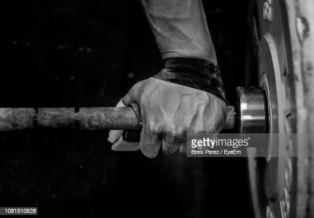 close-up of male hands holding weights - black and white hands stock pictures, royalty-free photos & images