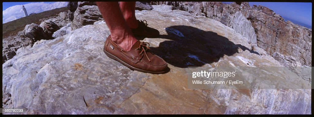 Close-Up Of Male Legs On Rocky Elevation : Foto stock