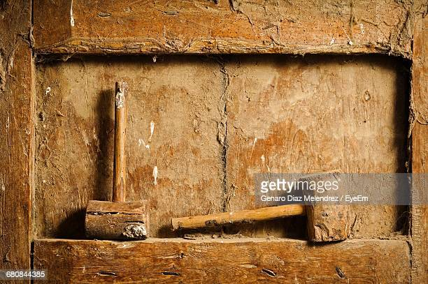 Close-up Of Mallets On Dirty Wooden Niche