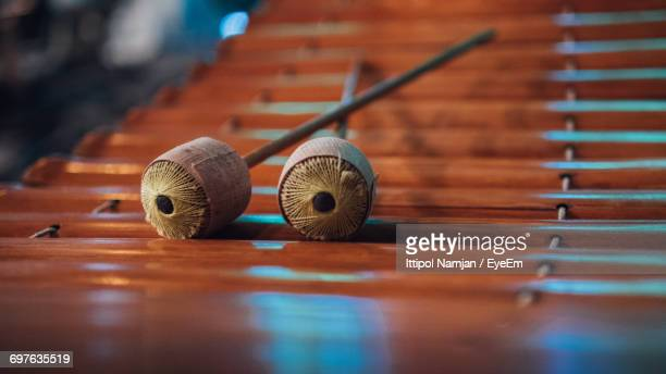 close-up of mallets on wooden xylophone - percussion mallet stock pictures, royalty-free photos & images