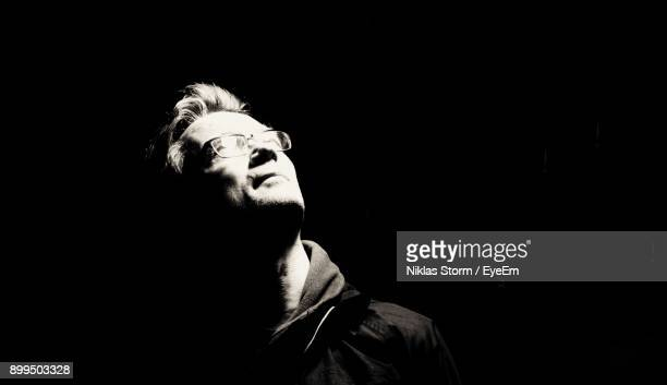 close-up of man against black background - niklas storm eyeem stock photos and pictures