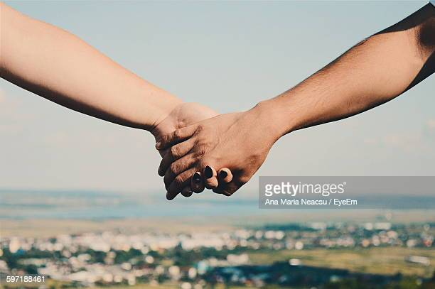 Close-Up Of Man And Woman Holding Hands