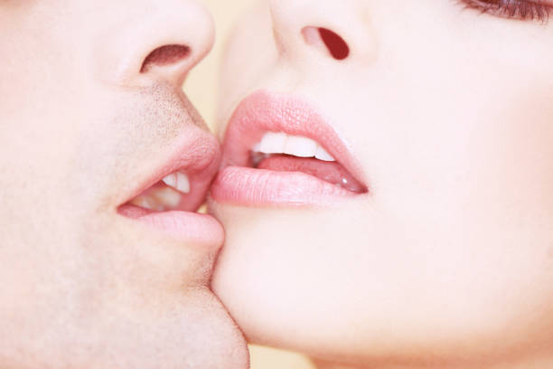 close-up of man and woman kissing