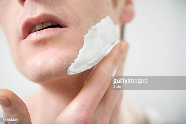 Close-up of man applying shaving cream