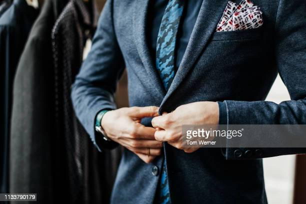 close-up of man buttoning up suit - coat stock pictures, royalty-free photos & images