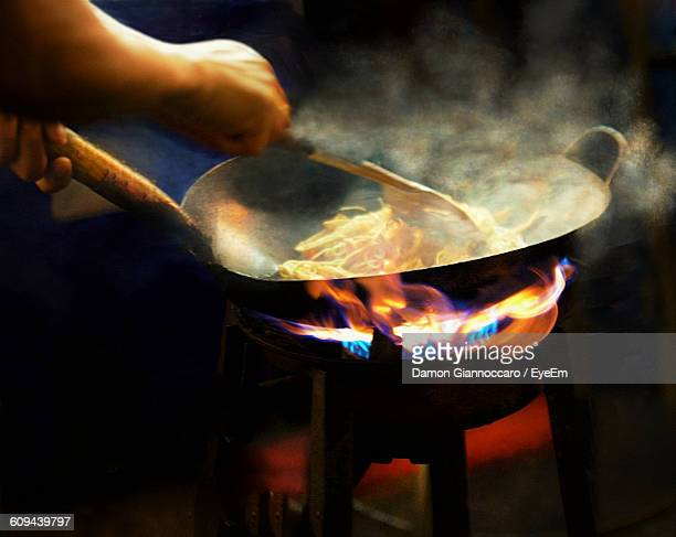 close-up of man cooking noodles  - street food stock pictures, royalty-free photos & images