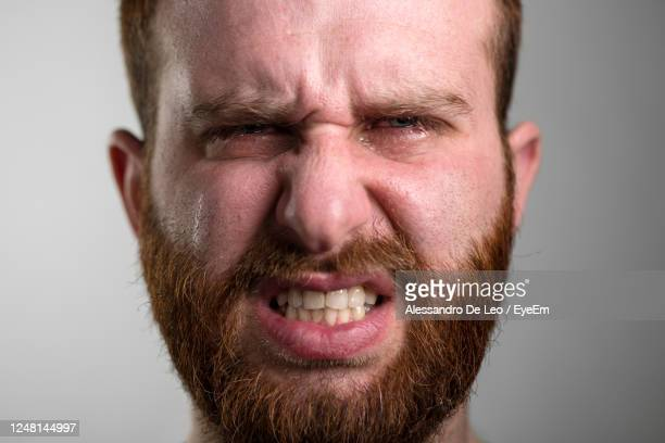 close-up of man crying - pulling funny faces stock pictures, royalty-free photos & images