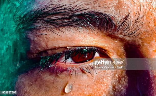 close-up of man crying - sweat stock pictures, royalty-free photos & images