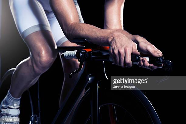 close-up of man cycling, studio shot - handlebar stock photos and pictures