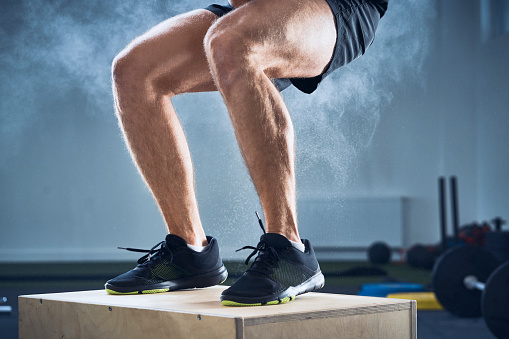 Closeup of man doing box jump exercise at gym - gettyimageskorea