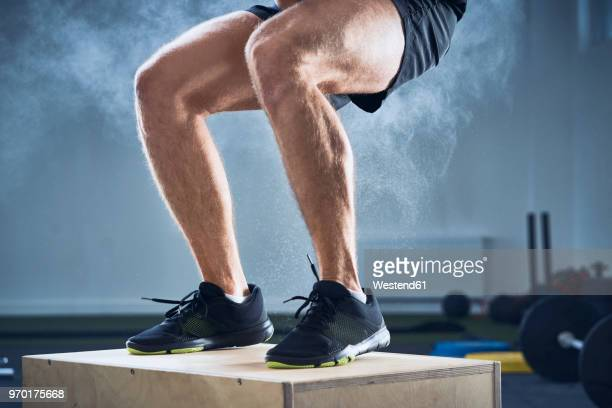 closeup of man doing box jump exercise at gym - leg stock pictures, royalty-free photos & images
