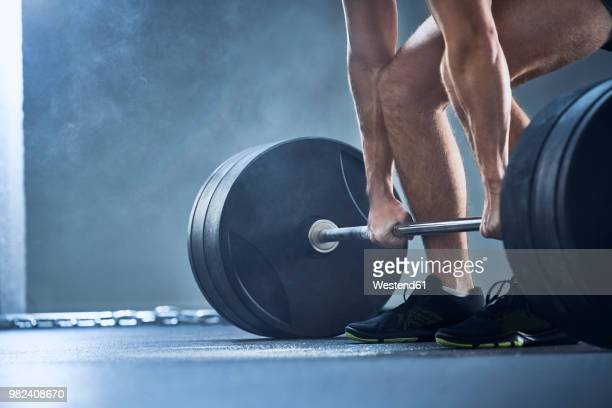 close-up of man doing deadlift exercise at gym - weight stock pictures, royalty-free photos & images