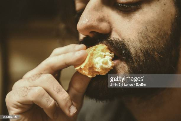 close-up of man eating cake - indulgence stock pictures, royalty-free photos & images