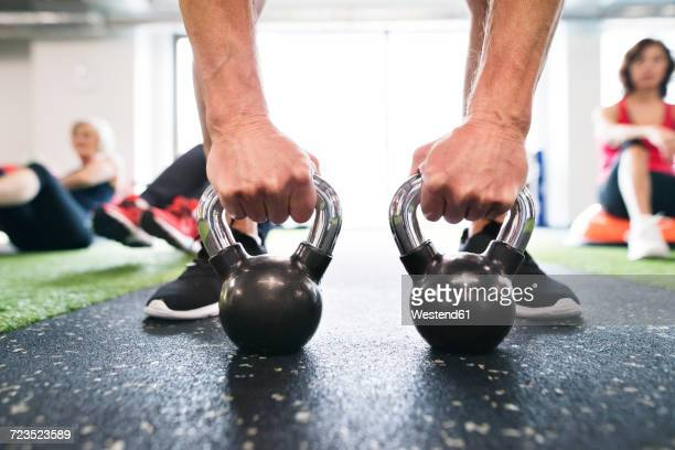 close-up of man exercising with kettlebells in gym - gripping stock pictures, royalty-free photos & images