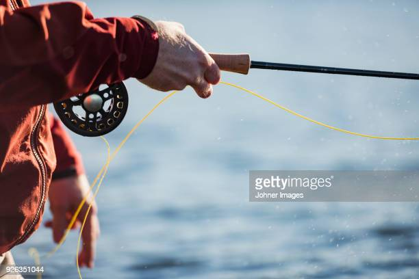 close-up of man fishing - commercial_fishing stock pictures, royalty-free photos & images