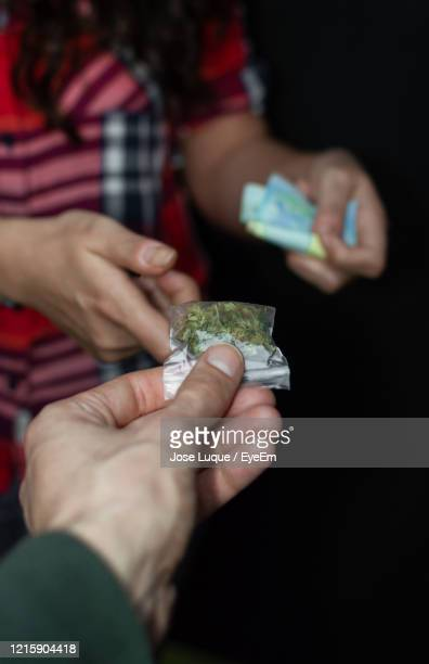 close-up of man giving marijuana to woman - drug dealer stock pictures, royalty-free photos & images
