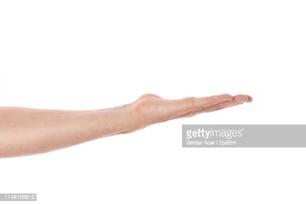 close-up of man hand gesturing against white background - human finger stock pictures, royalty-free photos & images
