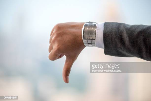 closeup of man hand showing thumbs down - veto stock pictures, royalty-free photos & images