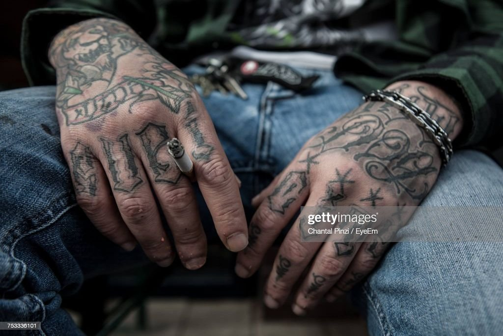Close-Up Of Man Hand With Tattoo : Stock Photo