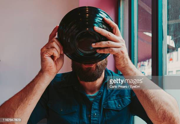 close-up of man having food while sitting by window in restaurant - obscured face stock pictures, royalty-free photos & images
