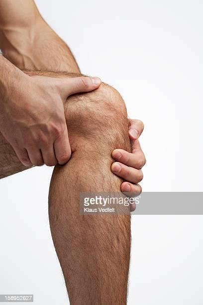 Close-up of man having knee pain
