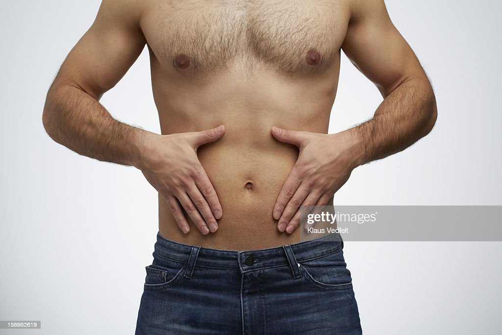 Close-up of man having stomach pain (front view) : Stock Photo