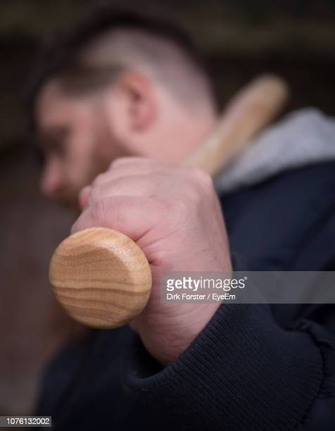 Close-Up Of Man Holding Baseball Bat