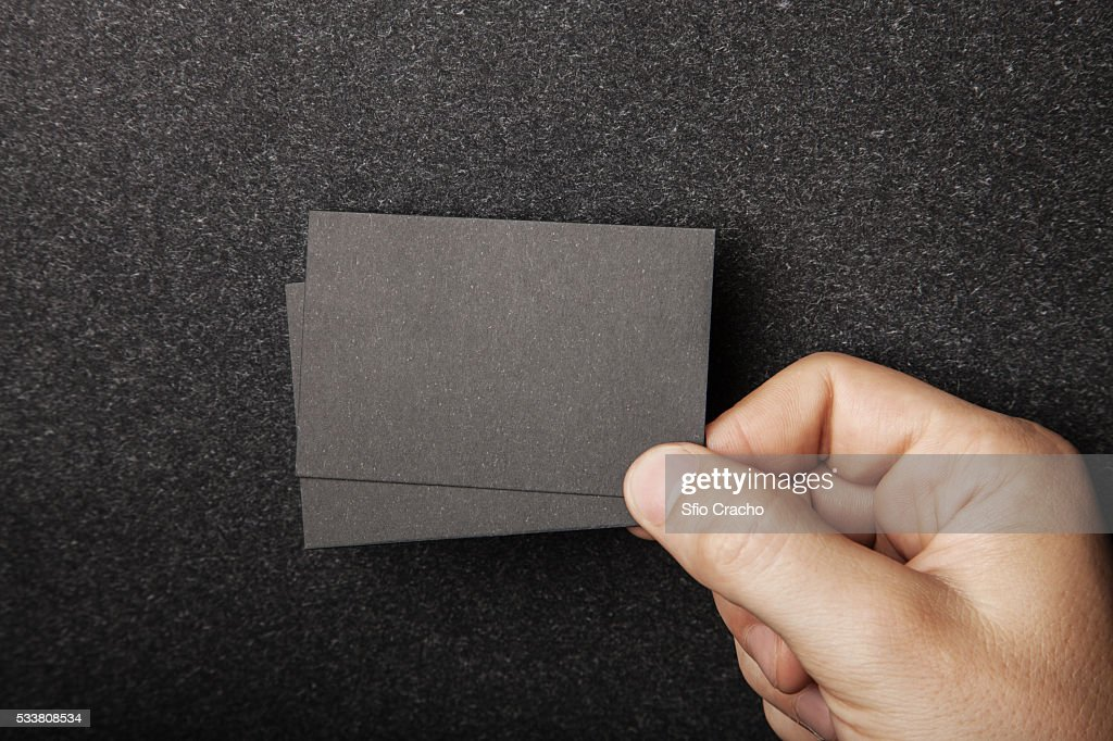 Close-up of man holding blank business cards : Foto stock