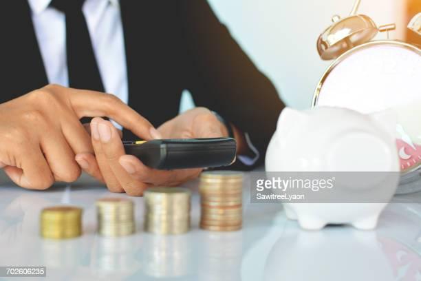 Close-Up Of Man Holding Calculator