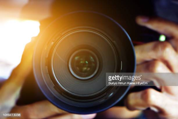 close-up of man holding camera - image focus technique stock pictures, royalty-free photos & images