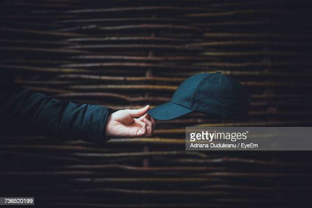 close-up of man holding cap - bones - fotografias e filmes do acervo