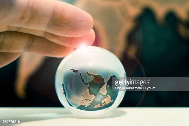 Close-Up Of Man Holding Crystal Ball