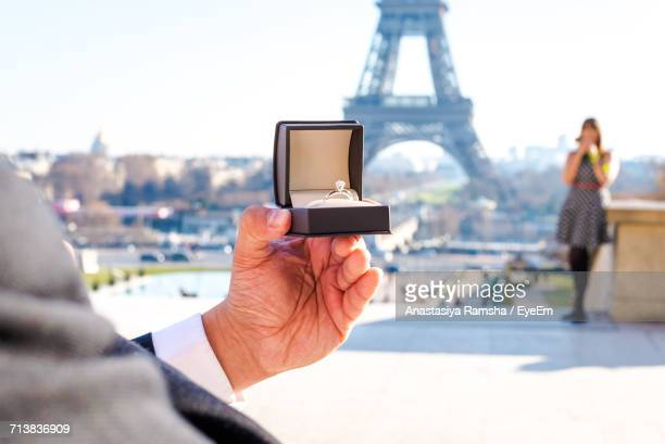close-up of man holding engagement ring - engagement ring box stock photos and pictures
