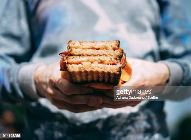 close-up of man holding food - adriana duduleanu stock photos and pictures