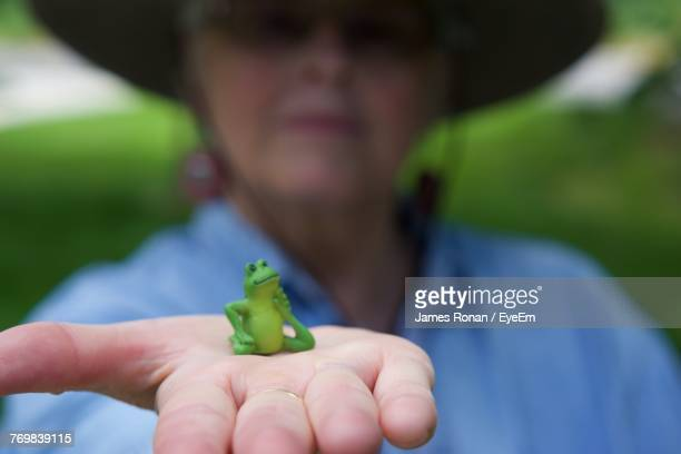 Close-Up Of Man Holding Frog