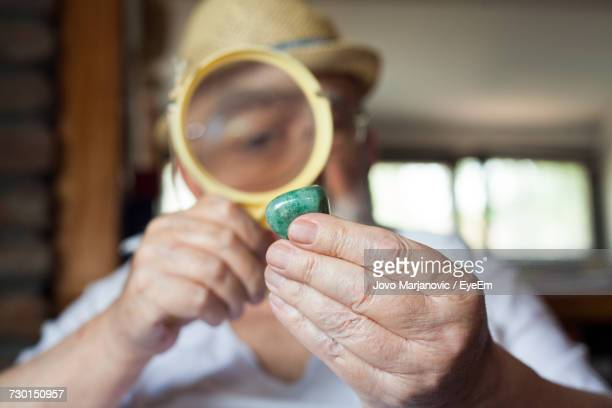 close-up of man holding gemstone - jeweller stock photos and pictures