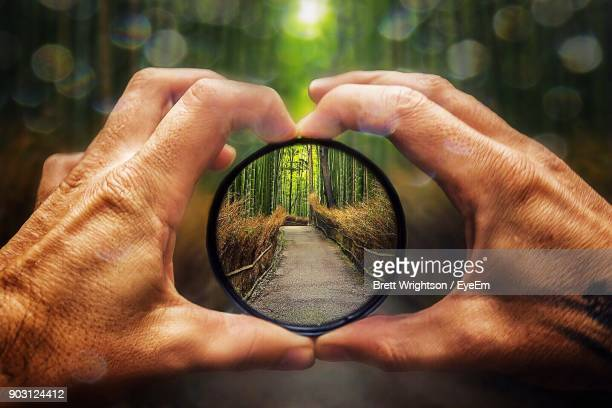 close-up of man holding lens - image focus technique stock pictures, royalty-free photos & images