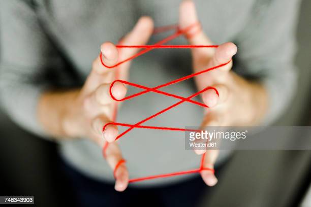 Close-up of man holding string