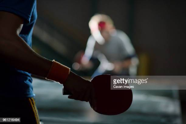 close-up of man holding table tennis racket - table tennis racket stock pictures, royalty-free photos & images