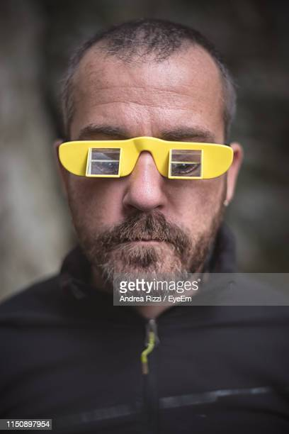 close-up of man in belay glasses - andrea rizzi fotografías e imágenes de stock