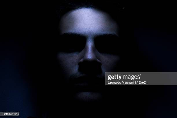 close-up of man in darkroom - scary face stock photos and pictures