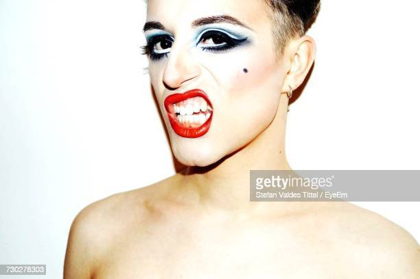 close-up of man in make-up - transvestite stock photos and pictures