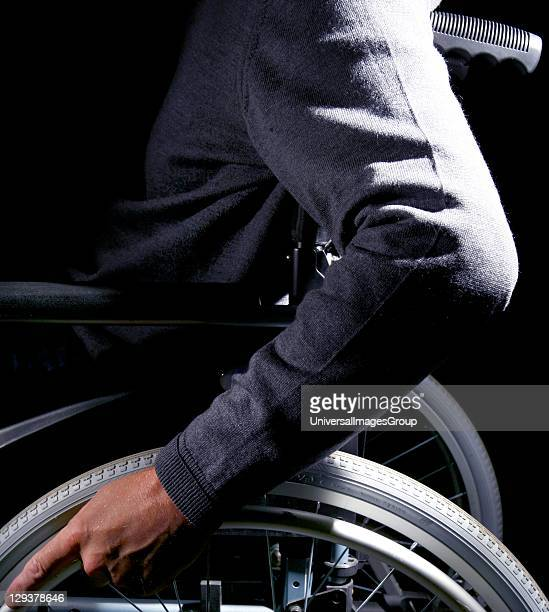 Close-up of man in wheelchair, midsection