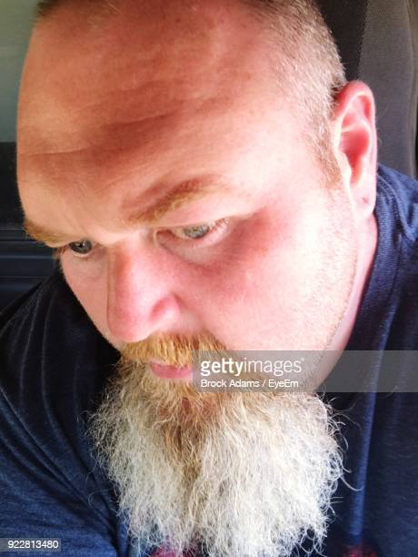 close-up of man looking down - adams tennessee stock pictures, royalty-free photos & images
