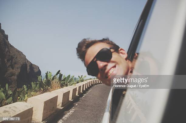 Close-Up Of Man Looking Out Car Window