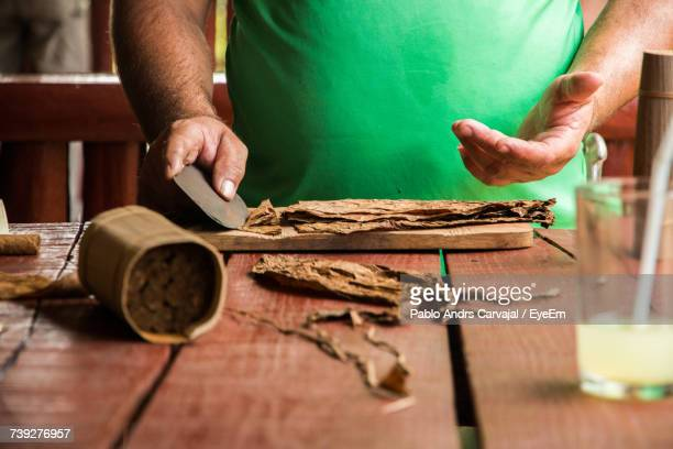 close-up of man making cigar - carvajal stock photos and pictures
